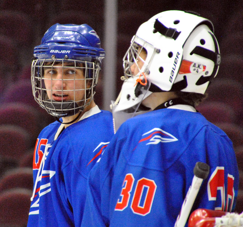 . Jon Behm - The Morning Journal<br> Bay\'s Jack Murray, left, talks with goalie Sean Gulley prior to the start of the second period against North Olmsted on Dec. 22 at The Q. Gulley had 43 saves in the Rockets\' loss.