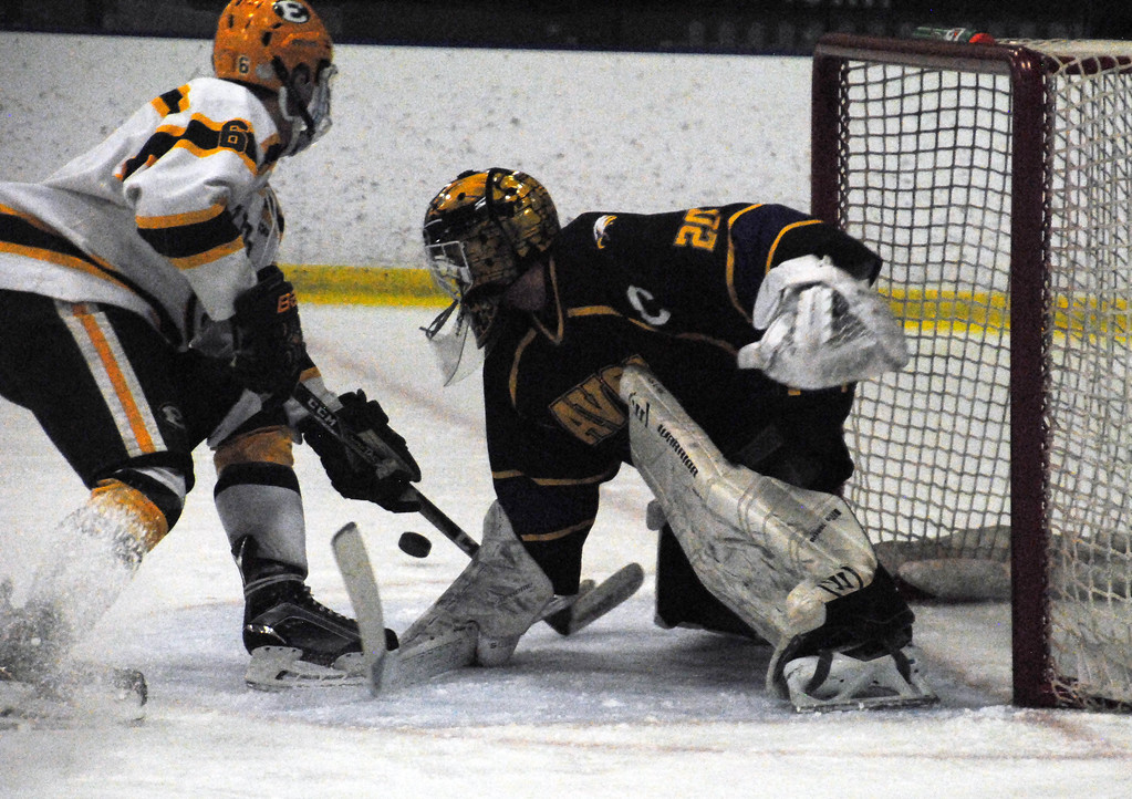. Jon Behm - The Morning Journal<br> Avon goalie Danny Fielding makes a save on St. Edward\'s Joseph Wilber during the first period of a Brooklyn District sectional semifinal on Feb. 18 at Brooklyn\'s John M. Coyne Recreation Center. Fielding had 54 saves in the loss.