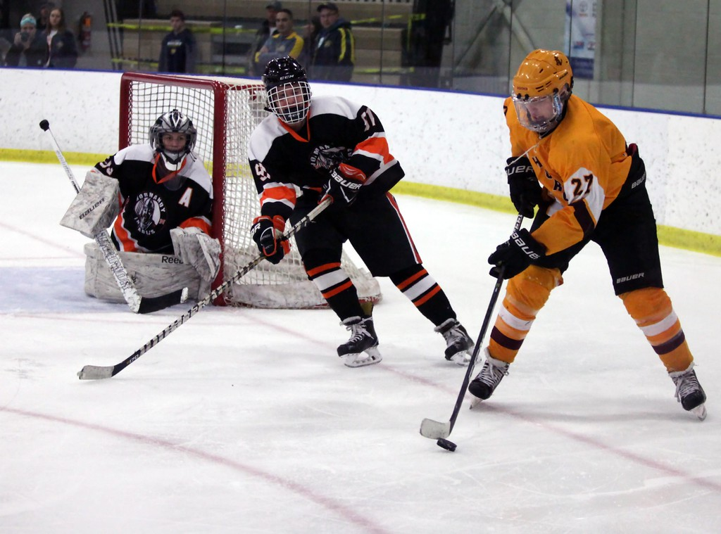 . Randy Meyers - The Morning Journal<br> Avon Lake\'s Patrick Graney moves the puck near the Normandy goal while Cody Tintelnot and goalie Hannah Franz defend during the Baron Cup III final on Feb. 11.