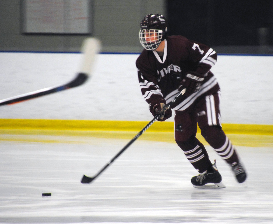 . Jon Behm - The Morning Journal<br> Rocky River junior Tommy Kelly looks for an open teammate during the second period of the Baron Cup I final against Shaker Heights on Feb. 11 at Brooklyn\'s John M. Coyne Recreation Center.