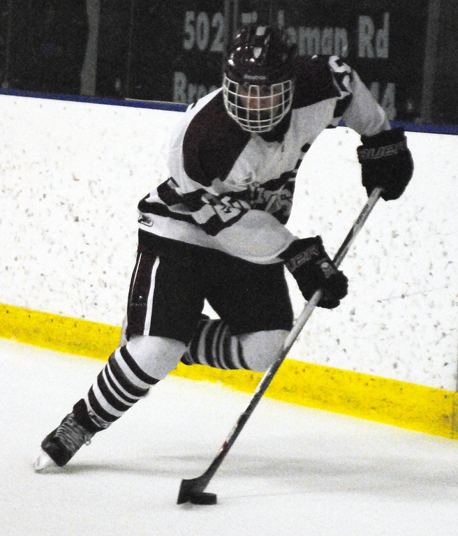 . Jon Behm - The Morning Journal<br> Rocky River\'s Luke Witzigreuter brings the puck around net against Avon Lake during the first period of a Brooklyn District sectional final on Feb. 20 at Brooklyn\'s John M. Coyne Recreaction Center.