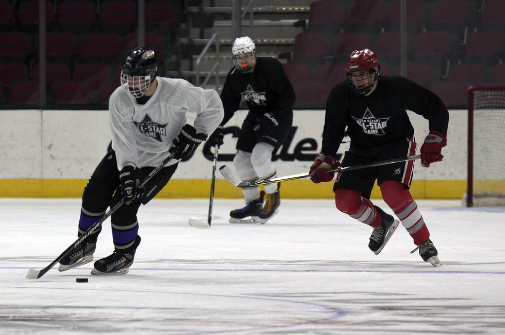 . Jen Forbus - The Morning Journal<br> Avon\'s Jacob Folds grabs possession of the puck in the first round of the GCHSHL All-Star Hockey game at the Quicken Loans Area on Sunday.