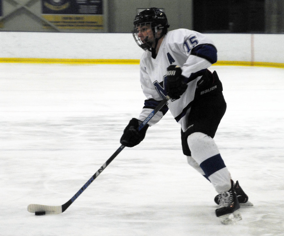 . Jon Behm - The Morning Journal<br> Midview senior Heath Naso looks to make a pass during the first period against Bay in a Brooklyn District first round game on Feb. 12 at Brooklyn\'s John M. Coyne Recreaton Center.