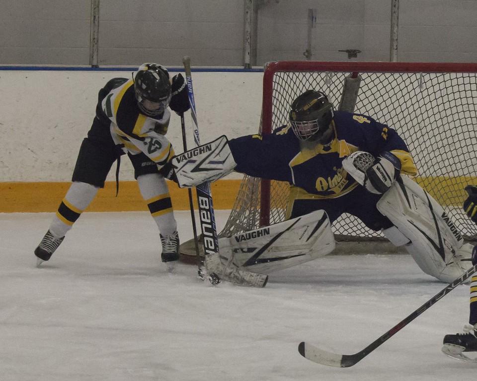 . Jen Forbus - The Morning Journal<br> Olmsted Falls goalie Angelo Hanson isn\'t letting Amherst\'s Jacob Kramer score on this shot.