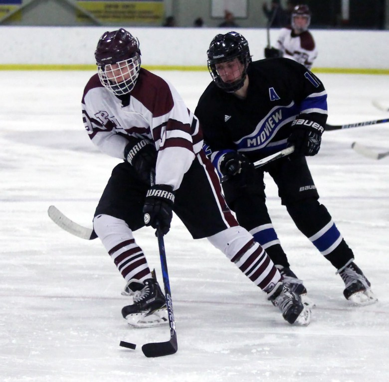 . Randy Meyers - The Morning Journal<br> Rocky River\'s Matt Stueber controls  the puck in front of Bryan Weaver of Midview on Feb. 8.