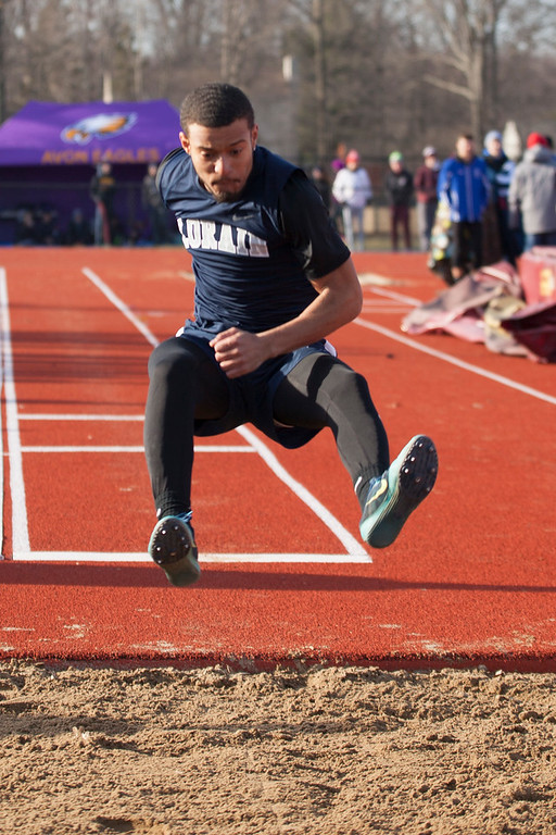 . Jen Forbus - The Morning Journal<br> Lorain\'s Rayshawn Ortiz leaps during the long jump competition at the Avon Lake Invitational on March 31.