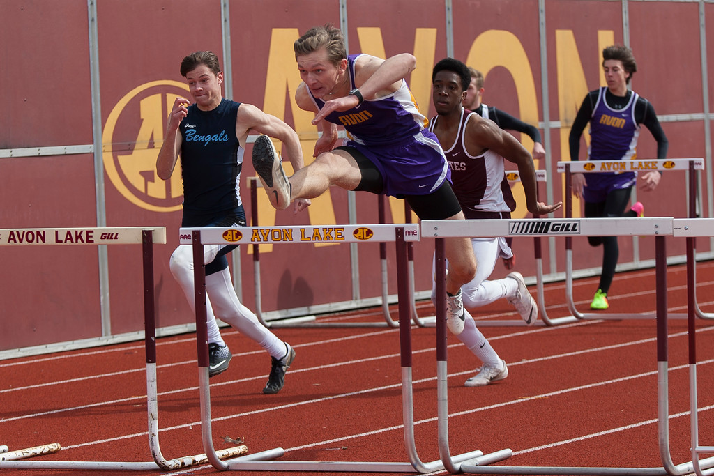 . Jen Forbus - The Morning Journal<br> Avon\'s Mike Rennette leaps the hurdle to win the boys 110 meter hurdle event during the Avon Lake Invitational on March 31.