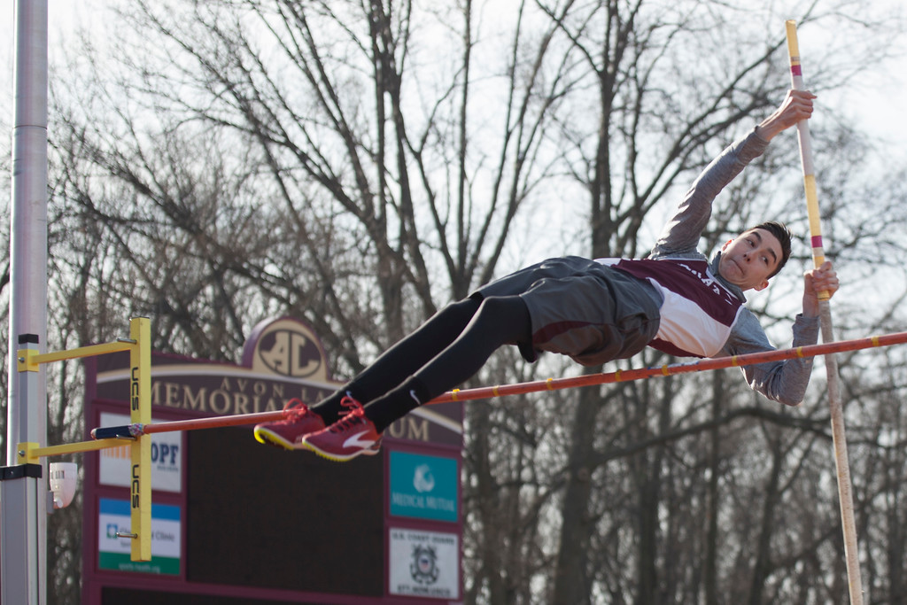 . Jen Forbus - The Morning Journal<br> Rocky River\'s Teagan Smith clears the bar during the pole vault at the Avon Lake Invitational on March 31.