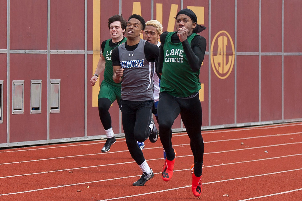 . Jen Forbus - The Morning Journal<br> Midview\'s Isiah Johnson challenges Lake Catholic\'s Del\'Mario Hairston in the boys 200 meter dash at the Avon Lake Invitational on March 31.