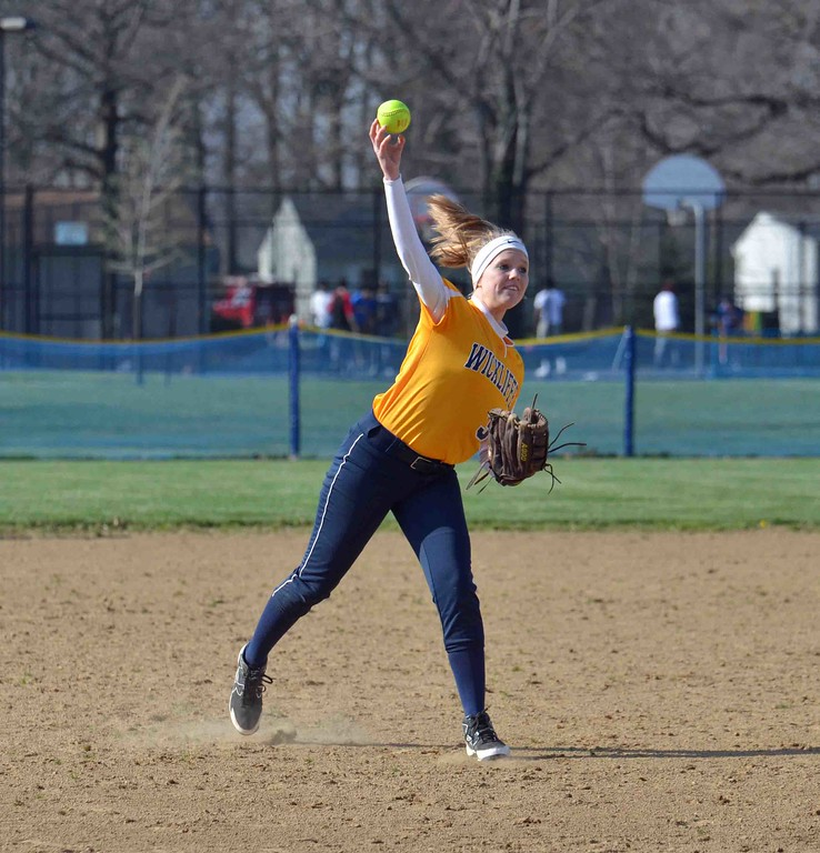 . Paul DiCicco - The News-Herald Wickliffe\'s Caitlyn Henderson fielding a grounder and throwing to first base for the out against Chagrin Falls on Apr 12.