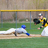 Barry Booher - The News-Herald<br /> Madison's Josh Gibson dives back to firstbase, on the pickoff throw to Austin Hejduk.