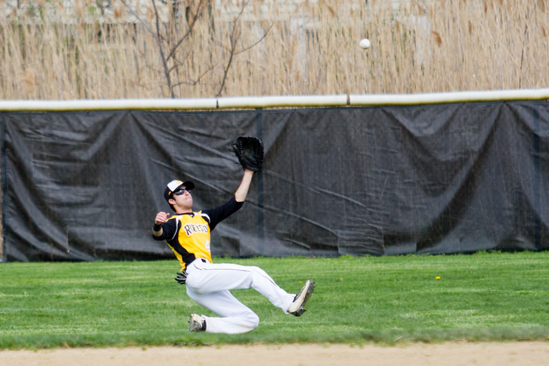 Barry Booher - The News-Herald<br /> Ryan Schwarzwalder makes a sliding catch against Madison.