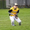 Barry Booher - The News-Herald<br /> Josh Carafa goes to his knees to take care of a fly ball.