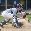 Barry Booher - The News-Herald<br /> Riverside's Brennan Griffin beats the throw home to catcher Owen Myers.