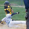 Barry Booher - The News-Herald<br /> Madison's Zak Wolfe slides by the tag from Zach Greben, with the go ahead run in the seventh inning.