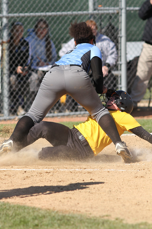 . Michael Johnson - The News-Herald Riverside\'s Allie Goldy (bottom) beats Mo Hodge\'s tag (top) at home plate to score a run.   Riverside defeated South 7-1 at Willoughby South High School.