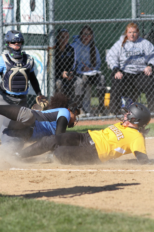 . Michael Johnson - The News-Herald Riverside\'s Allie Goldy (right) beats Mo Hodge\'s tag (left) at home plate to score a run in today\'s game. Riverside defeated South 7-1 at Willoughby South High School.
