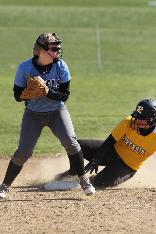 . Michael Johnson - The News-Herald Willoughby South second baseman, Paige MacMullan looks to complete a double play against Riverside.  Riverside defeated South 7-1 at Willoughby South High School.