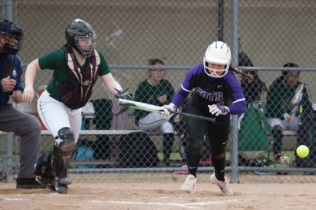 . Jen Forbus - The Morning Journal<br> Keystone\'s Autumn Acord lays down a bunt against Akron SVSM on April 14.