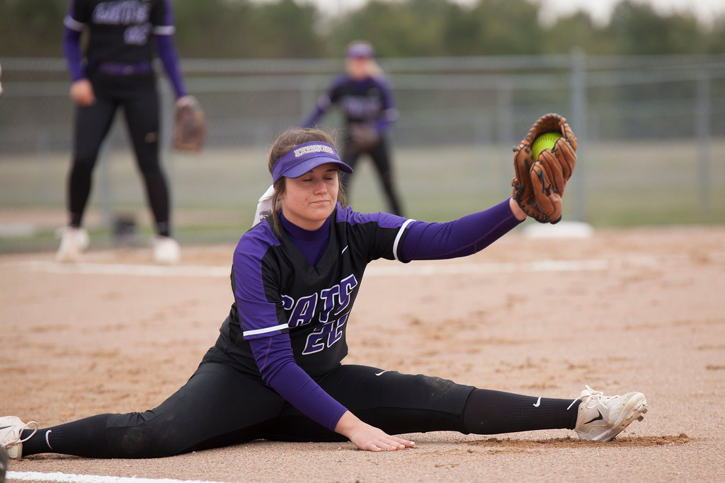 . Jen Forbus - The Morning Journal<br> Keystone first baseman Brooke Piazza stretches all the way to secure an out against Akron SVSM on April 14.