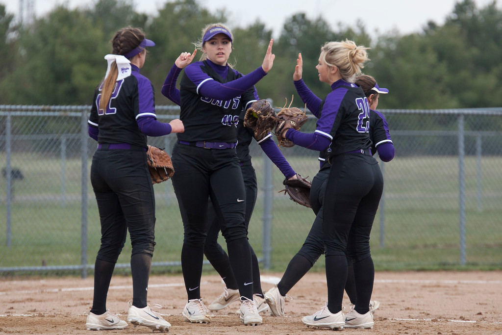 . Jen Forbus - The Morning Journal<br> The Wildcats\' infield celebrates a strikeout from pitcher Sydney Campbell, center, agianst Akron SVSM on April 14.