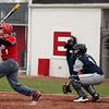 Randy Meyers - The Morning Journal<br /> Seth France of Elyria smacks a home run against Lorain during the first game of a doubleheader on April 15.