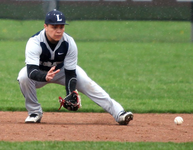 . Randy Meyers - The Morning Journal Lorain\'s Savien Armador makes a play on a ground ball in light rain during the first game of a doubleheader against Elyria on April 15.