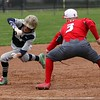 Randy Meyers - The Morning Journal<br /> Lorain's Blake Bartlome is tagged out at third by Jordan Reed of Elyria during the first game of a doubleheader on April 15.