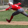 Randy Meyers - The Morning Journal<br /> Elyria's third baseman Jordan Reed stretches for the ball against Lorain on April 15.