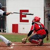 Randy Meyers - The Morning Journal<br /> Lorain's Julian Rodriguez pops up against Elyria for an out during the first game of a doubleheader on April 15.