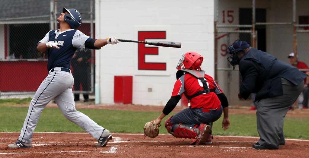 . Randy Meyers - The Morning Journal Lorain\'s Julian Rodriguez pops up against Elyria for an out during the first game of a doubleheader on April 15.