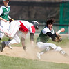 Barry Booher - The News-Herald<br /> Perry's Paul Pearson collides with Lake's second baseman Nick Caplick who was fielding a ground ball. Pearson was out on runner interference.