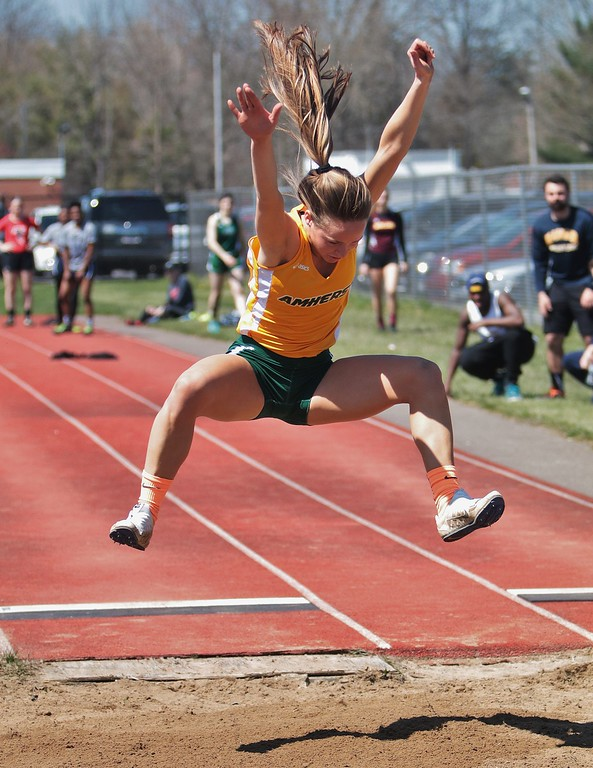 . Amanda K. Rundle - The Morning Journal Amherst\'s Madison Reynolds comptes in the long jump at the LCAAA track meet on April 16 at Avon.