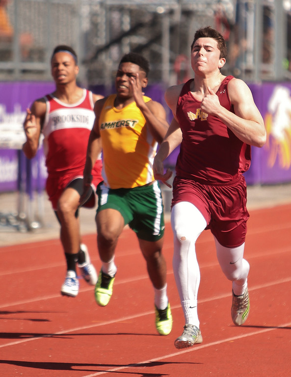 . Amanda K. Rundle - The Morning Journal Avon Lake\'s Caleb Burr, right, inches past the competition in the 100 meter dash at the LCAAA track meet on April 16 at Avon.
