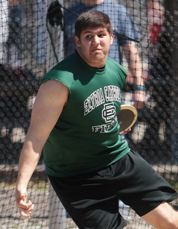 . Amanda K. Rundle - The Morning Journal Elyria Catholic\'s Ted Achadis prepares to launch the discus at the LCAAA track meet on April 16 at Avon.