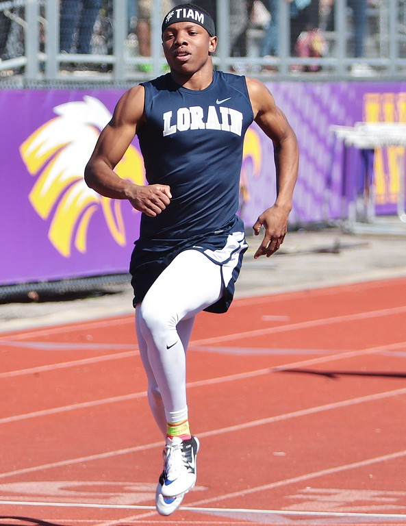 . Amanda K. Rundle - The Morning Journal Lorain\'s Zion Cross leads the boys in the 100 meter dash at the LCAAA track meet on April 16 at Avon.