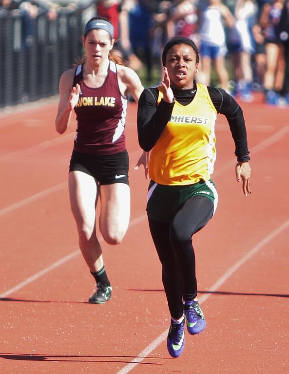 . Amanda K. Rundle - The Morning Journal Amherst\'s Taylor Hooks, right, set a new meet record in the 100 meter dash at the LCAAA track meet on April 16 at Avon.