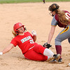 Don Knight | The Herald Bulletin<br /> Alexandria's Tristen Dunn tags Anderson's Emma Kelley out at third base on Tuesday.