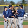 Paul DiCicco - The News-Herald<br />  South's infield gathering on the mound pre-inning for a pep-talk.
