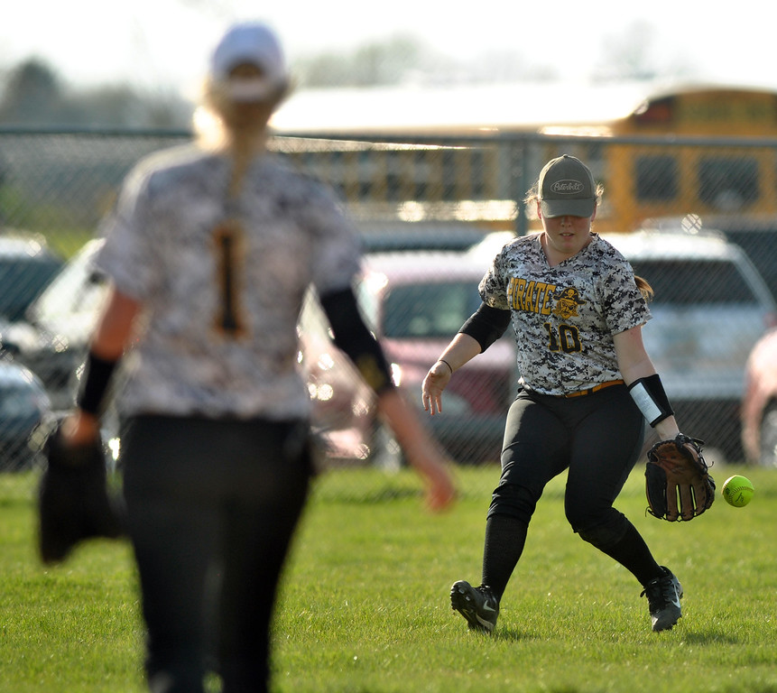 . Jon Behm - The Morning Journal Black River\'s Kaitlyn Unangst (10) chases down a hit while Elizabeth Rogers waits for the cut-off throw during the bottom of the third inning against Keystone on April 18 at LaGrange Community Park.