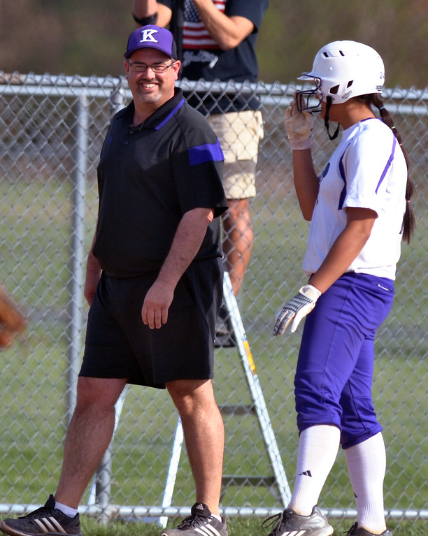 . Jon Behm - The Morning Journal Keystone coach Jim Piazza, left, smiles while talking with junior Sammie Stefan during the bottom of the first inning against Black River on April 18 at LaGrange Community Park.