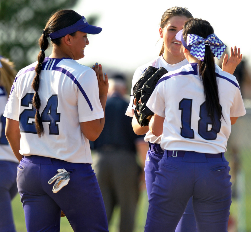 . Jon Behm - The Moring Journal Keystone junior Lauren Shaw, center, celebrates a strike out with juniors Sammie Stefan, left, and Kodi Akers during the top of the second inning against Black River on April 18 at LaGrange Community Park. Shaw had seven strikeouts in the Wildcats victory.