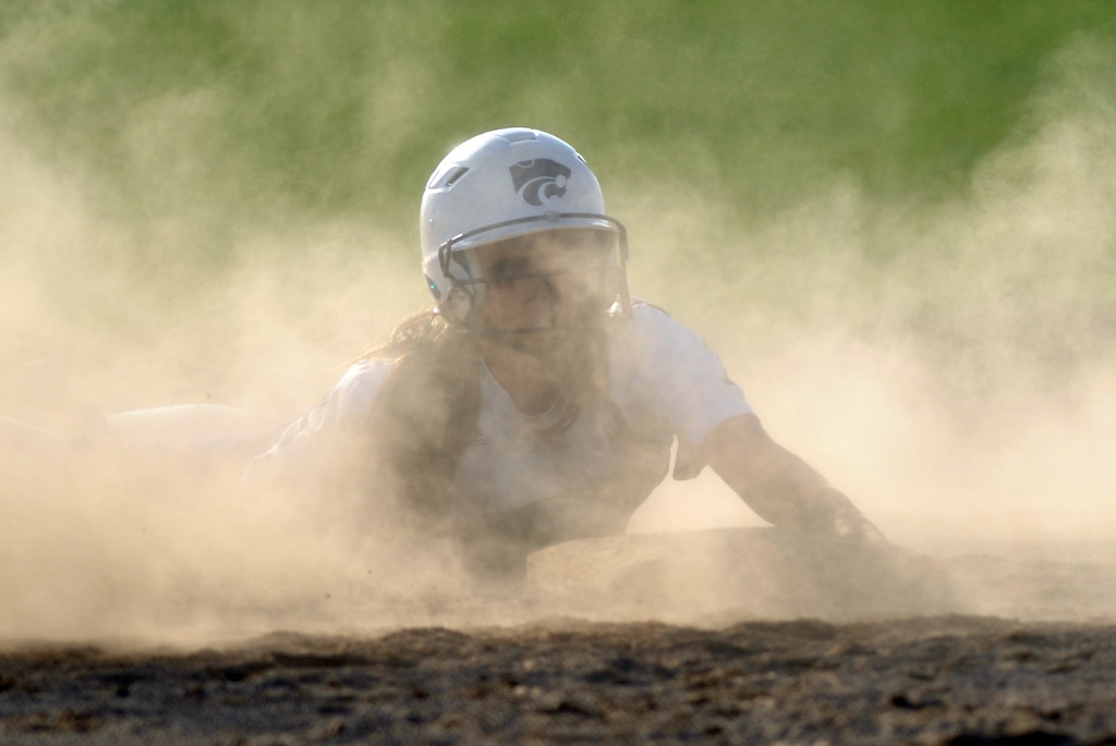 . Jon Behm - The Morning Journal Keystone freshman Autumn Acord looks through the dust to coach Jim Piazza at third base for instructions after stealing second during the bottom of the fourth inning against Black River on April 18 at LaGrange Community Park.