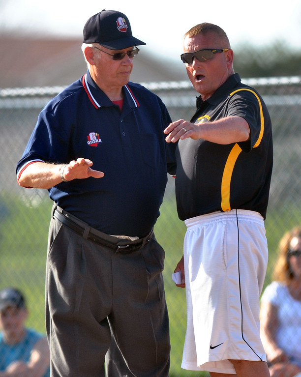 . Jon Behm - The Morning Journal Black River coach Lawrence Toth, right, debates a call with the umpire during the bottom of thr third inning against Keystone on April 18 at LaGrange Community Park.