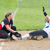 Barry Booher - The News-Herald<br /> Madison's  Jordan Pasalaqua slides under the tag of Chardon's Bri Kuty during the Blue Streaks' 2-1 victory over Chardon on April 21. Pasalaqua went to third on a passed ball.