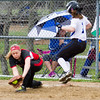 Barry Booher - The News-Herald<br /> Chardon's first baseman  Beth Furlich stretches out and gets Madison's Liz Montgomery by a hair during the Blue Streaks' 2-1 victory over Chardon on April 21.