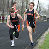 Michael Johnson - The News-Herald<br /> Chagrin's Collin Morell (left) takes the baton from Joe Bistritz (right) in the Men's Distance Medley Relay during the Ranger Relays at North High School on April 23, 2016.