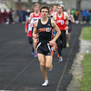 Michael Johnson - The News-Herald<br /> Chagrin's Joe Bistritz wins the Men's 1600 Meter race during the Ranger Relays at North High School on April 23, 2016.