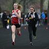 Michael Johnson - The News-Herald<br /> Emma Urbic of Chardon (left) races alongside Riverside's Abby Baker (right) in the Women's 4x800 Meter Relay during the Ranger Relays at North High School on April 23, 2016.