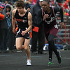 Michael Johnson - The News-Herald<br /> Chagrin's Joe Bistritz and Maple Heights' Cory McGaughy race in the Men's 1600 Meter race during the Ranger Relays at North High School on April 23, 2016.